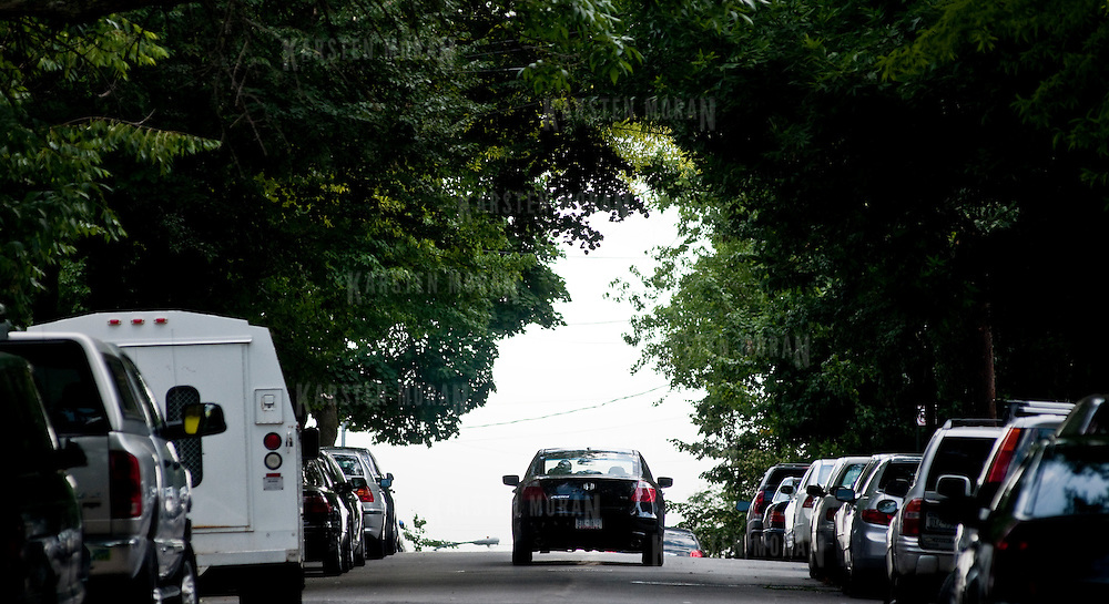 June 3, 2010 - Bronx, NY : A car crests the hill on Adrian Ave. in Mable Hill.