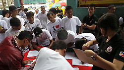 September 30, 2016 - Tanauan City, Batangas, Philippines - Drug surrenders registering their names to monitor that they are attending the rehabilitation program for them. (Credit Image: © Sherbien Dacalanio/Pacific Press via ZUMA Wire)