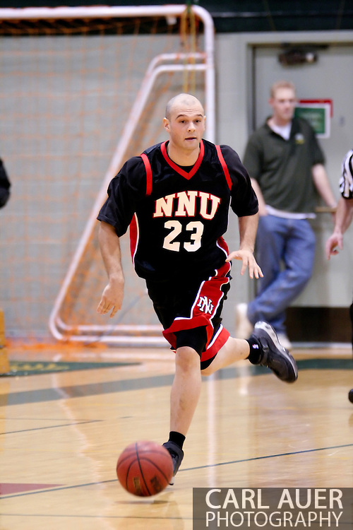 1/13/2006: Marcus Clift of the Northwest Nazarene University Crusaders brings the ball down court in the loss to Alaska Anchorage in a comeback win over Northwest Nazarene, 60-57, in men?s basketball action at the Wells Fargo Sports Complex on Saturday.