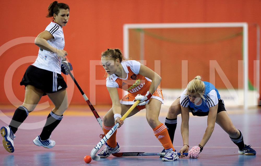 Prague - EuroHockey Indoor Championship (W) 2014<br /> 07 NED v GER (Pool B )<br /> foto: Mila MUYSELAAR with Kristina Hillmann.<br /> FFU PRESS AGENCY COPYRIGHT FRANK UIJLENBROEK