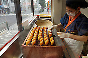 woman making a Japanese sweet potato snack called ImoKinntuba
