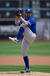 OAKLAND, CA - JULY 23:  R.A. Dickey #43 of the Toronto Blue Jays pitches against the Oakland Athletics during the first inning at O.co Coliseum on July 23, 2015 in Oakland, California. The Toronto Blue Jays defeated the Oakland Athletics 5-2. (Photo by Jason O. Watson/Getty Images) *** Local Caption *** R.A. Dickey