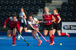 East Grinstead's Laura Unsworth is watched by Eleanor Watton of Holcombe. East Grinstead v Holcombe - Semi-Final - Investec Women's Hockey League Finals, Lee Valley Hockey & Tennis Centre, London, UK on 22 April 2017. Photo: Simon Parker
