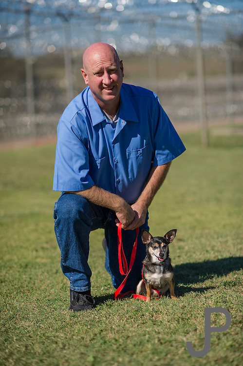 Lexington Correctional Facility inmates training dogs