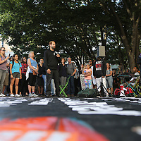 Event organizer Mohawk Kuzma speaks to protesters prior to a Black Lives Matter march, Saturday, August 26, 2017, in Seattle, Washington. Several thousand people attended a downtown rally and then marched through the city to call attention to minority rights and police brutality. (Alex Menendez via AP)