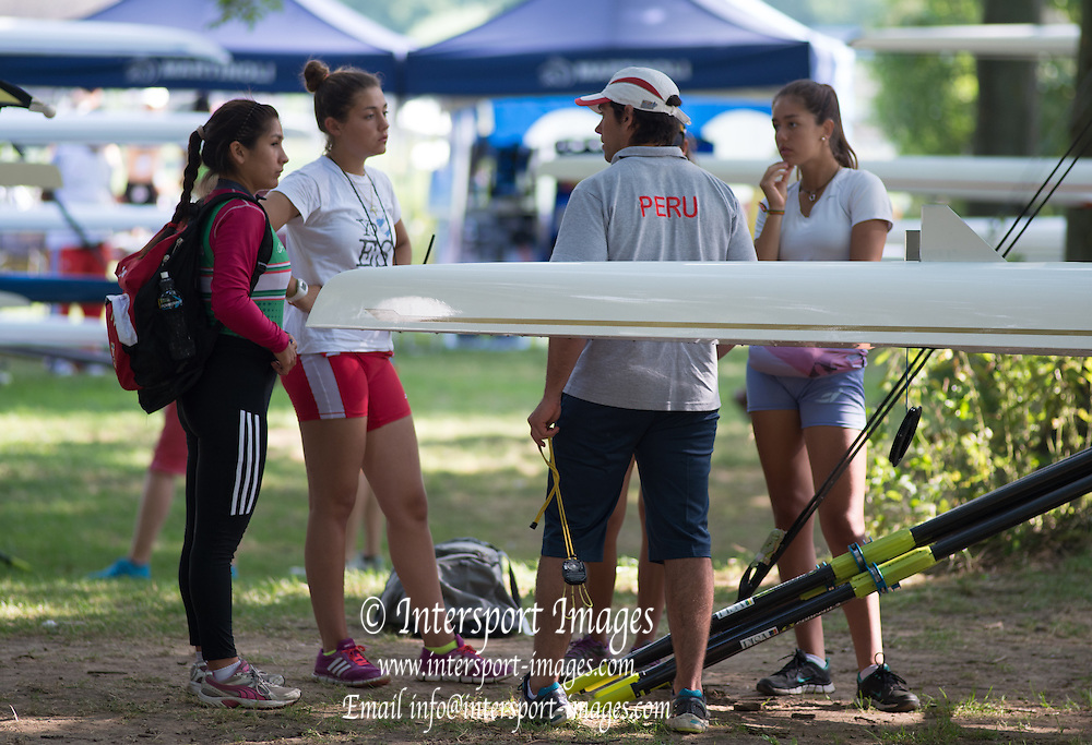 Hamburg. GERMANY. Peru coach chats with his athletes in the boat park area at the FISA Junior World Championships.  10:08:21  Tuesday  05/08/2014  [Mandatory Credit; Peter Spurrier/Intersport-images]