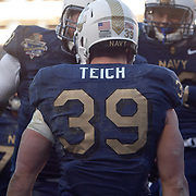 Navy fullback Alexander Teich #39 celebrates with his teammates in the North end zone after rushes for 10 yards and the NAVY touchdown late in the second quarter Saturday, Dec. 10, 2011 at Fed EX field in Landover Md.<br /> <br /> Navy set the tone early in the game as Navy defeats Army 31-17 in front of 82,000 at Fed EX Field in Landover Md.