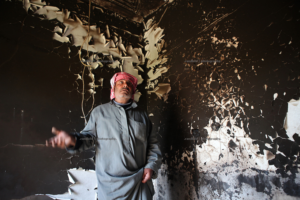 Ahmed Naib Saruf in his burnt house in Deir Sunbul. Deir Sunbul (contested Jabal Al-Zawiha area) was beeing attacked by syrian army in April, leaving several people dead. Many houses were set on fire by Assad loyalists and inhabitants fled the region fearing new attacks.