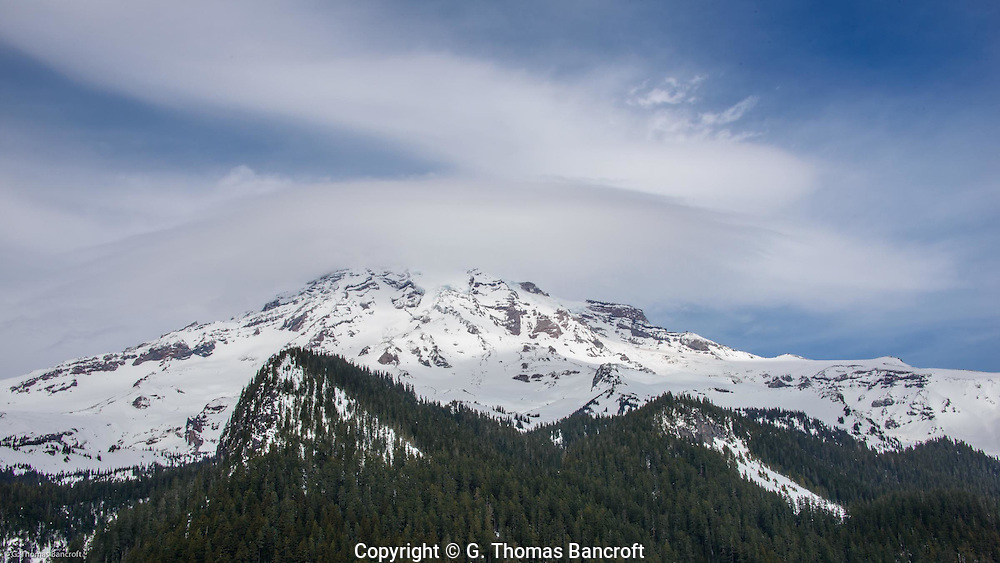 A lenticular cloud covered Mt Rainier.