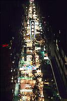 Market stalls & people at the crowded Temple Street Night Market, Kowloon, Hong Kong, China.