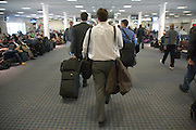 businessmen walking to there airplane gate