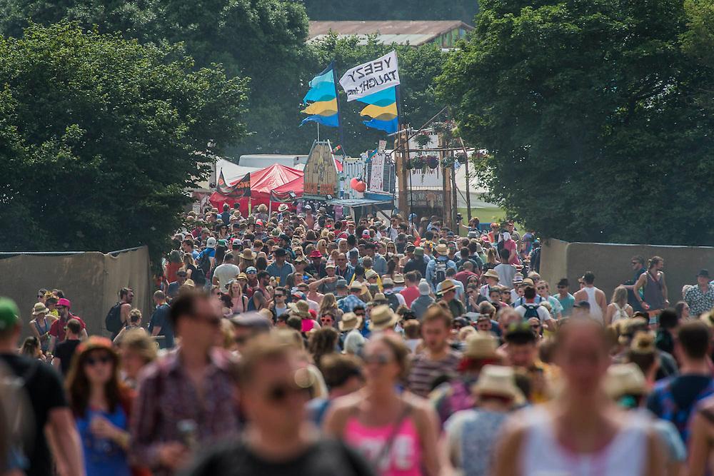 All routes are crowded. The 2015 Glastonbury Festival, Worthy Farm, Glastonbury.