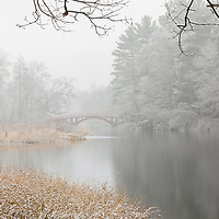 During the recently snow storm, I explore my Natick neighborhood and returned to this beautiful footbridge in South Natick. Sargent Bridge, is a red wooden arch bridge surrounded by foliage and made for fine winter photography images.  <br />