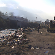 In the Roma ghetto many of the services provided to cities are not provided such as waste collection. The Roma in the Kjustendil ghetto use the area around the river crossing the ghetto for waste disposal and for burning the rubbish.