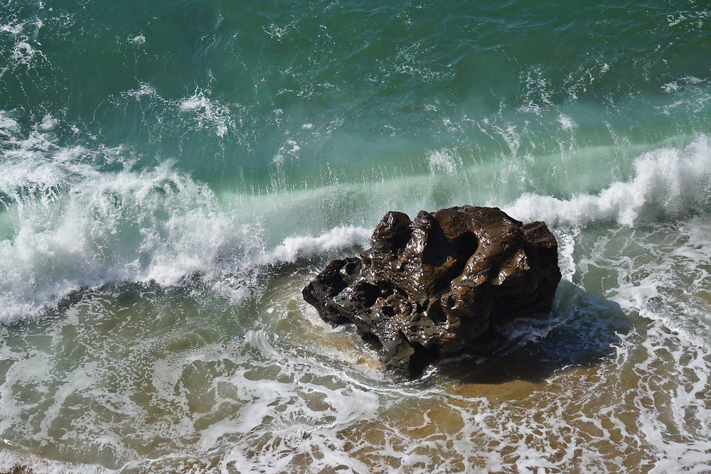 Aerial view of a large coastal rock on the Northern California coast.