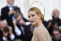 Rosie Huntington-Whiteley walking the red carpet at The Metropolitan Museum of Art Costume Institute Benefit celebrating the opening of Heavenly Bodies : Fashion and the Catholic Imagination held at The Metropolitan Museum of Art  in New York, NY, on May 7, 2018. (Photo by Anthony Behar/Sipa USA)