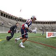 Paul Rabil #99 of the Boston Cannons runs onto the field prior to the game at Harvard Stadium on April 27, 2014 in Boston, Massachusetts. (Photo by Elan Kawesch)