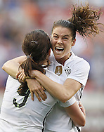 Feb 21, 2016; Houston, TX, USA; USA defender Kelley O'Hara (5) celebrates midfielder Lindsey Horan (9)  goal against Canada in the second half during the 2016 CONCACAF women's Olympic soccer tournament at BBVA Compass Stadium. USA won 2 to 0. Mandatory Credit: Thomas B. Shea-USA TODAY Sports