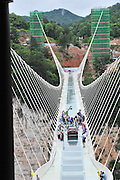 ZHANGJIAJIE, CHINA - JUNE 25:<br /> <br />  Image shows the glass-bottomed bridge receiving a safety test at Zhangjiajie Grand Canyon on June 25, 2016 in Zhangjiajie, Hunan Province of China. World\'s tallest and longest glass-bottomed bridge has been completed and took a global broadcast through television and internet medias to show its safety. More than thirty citizens and visitors thumped the bridge with hammer in the test event. <br /> ©Exclusivepix Media