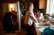 Wendy Jeub bathes her daughter Priscilla in the kitchen sink in their home in Monument, Colorado July 19, 2009. Quiverfull believers Wendy and Chris Jeub have 15 children and would be happy to have more if God wills it they say. REUTERS/Rick Wilking (UNITED STATES)