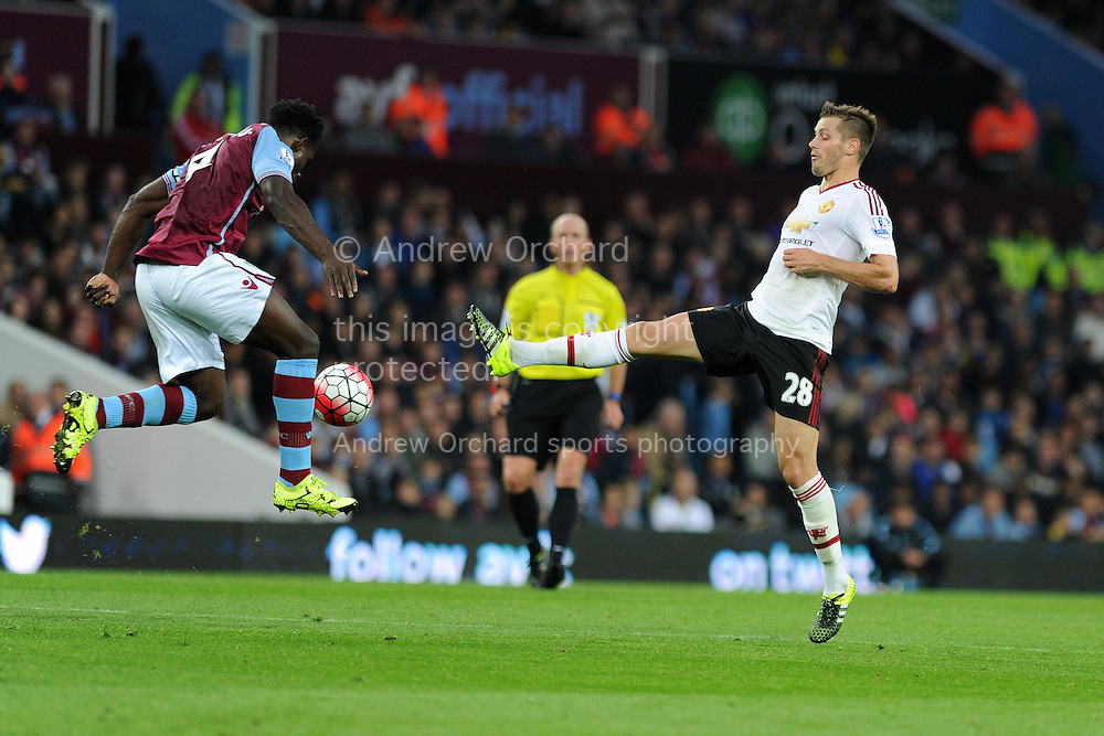 Morgan Schneiderlin of Manchester Utd  &reg; challenges Micah Richards of Aston Villa (l). Barclays Premier League match, Aston Villa v Manchester Utd at Villa Park in Birmingham, Midlands on Friday 14th August  2015.<br /> pic by Andrew Orchard, Andrew Orchard sports photography.