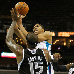 Jan 21, 2013; New Orleans, LA, USA; New Orleans Hornets power forward Anthony Davis (23) shoots over Sacramento Kings center DeMarcus Cousins (15) during the first quarter of a game at the New Orleans Arena. Mandatory Credit: Derick E. Hingle-USA TODAY Sports