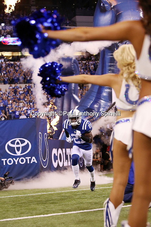 Indianapolis Colts cornerback Vontae Davis (21) runs onto the field during player introductions at the Indianapolis Colts 2015 NFL week 2 regular season football game against the New York Jets on Monday, Sept. 21, 2015 in Indianapolis. The Jets won the game 20-7. (©Paul Anthony Spinelli)