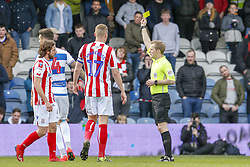 March 9, 2019 - London, England, United Kingdom - Referee Gavin Ward shows a yellow card to Queens Park Rangers Grant Hall during the second half of the Sky Bet Championship match between Queens Park Rangers and Stoke City at Loftus Road Stadium, London on Saturday 9th March 2019. (Credit Image: © Mi News/NurPhoto via ZUMA Press)