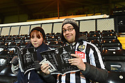 Notts County supporters reading the match day program during the The FA Cup match between Notts County and Bristol Rovers at Meadow Lane, Nottingham, England on 3 November 2017. Photo by Jon Hobley.