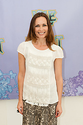 © Licensed to London News Pictures. 12/06/2015. Isle of Wight, UK.   Sharon Corr at Isle of Wight Festival 2015 on Friday Day 2.  Sharon Corr is performing as a solo artist at the festival this weekend.  She is best known as a member of the pop-rock band The Corrs, Yesterday the weather was hot and Sunny.  Today rain is forecast.  This years festival include headline artists the Prodigy, Blur and Fleetwood Mac.  Photo credit : Richard Isaac/LNP