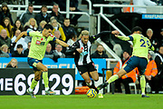 Joelinton (#9) of Newcastle United takes on Dominic Solanke (#9) of AFC Bournemouth and Philip Billing (#29) of AFC Bournemouth during the Premier League match between Newcastle United and Bournemouth at St. James's Park, Newcastle, England on 9 November 2019.