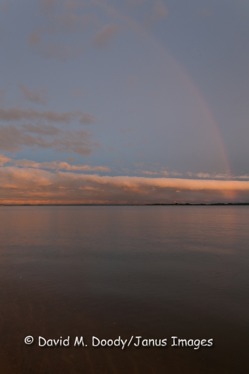 "Scenic clouds at sunset  with rainbow over the James River along the Colonial National Parkway between Jamestown and Williamsburg Virginia. Colonial National Historical Park (U.S. National Park Service,) in Virginia's ""Historic Triangle"""