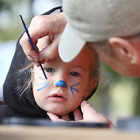 Emersyn Gillespie, 2, gets her face painted Saturday at the Tupleo Buffalo Park's Pumpkin Patch