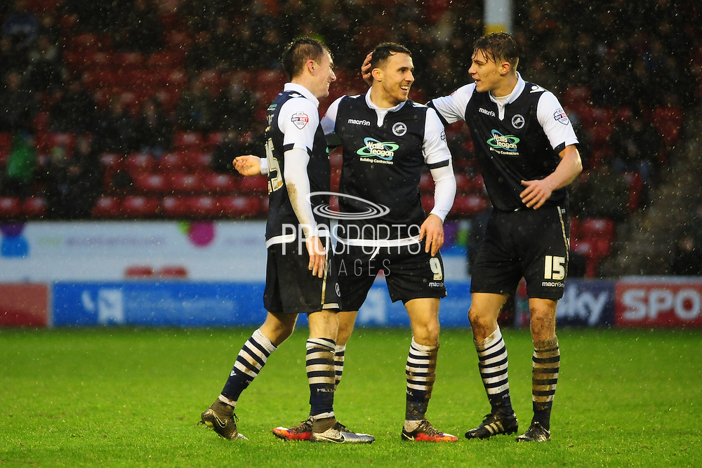 Lee Gregory of Millwall FC is congratulated after making it 3-0 during the Sky Bet League 1 match between Walsall and Millwall at the Banks's Stadium, Walsall, England on 6 February 2016. Photo by Mike Sheridan.