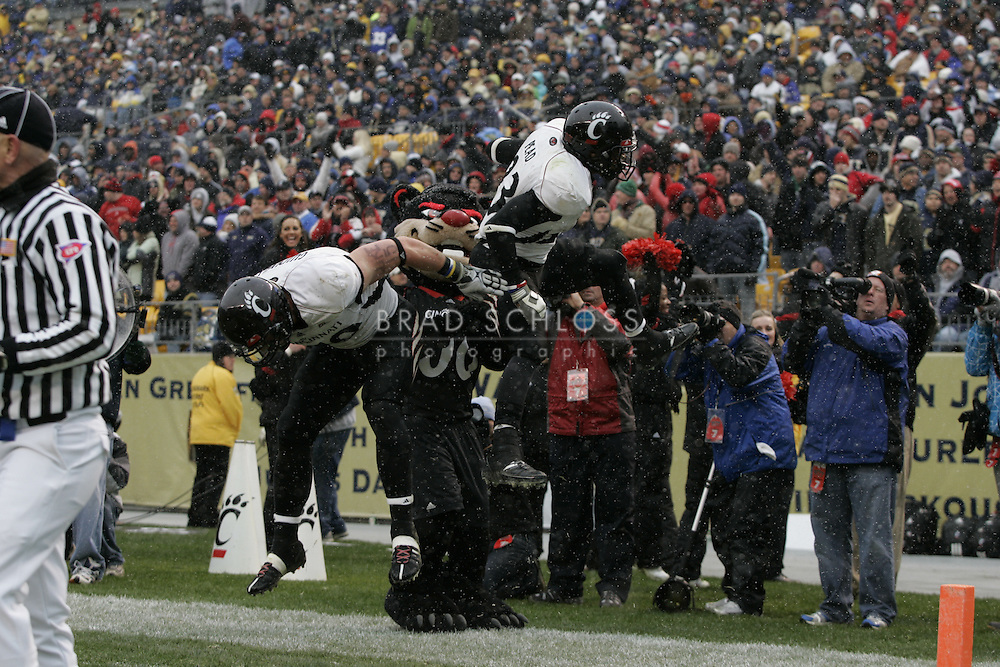 05 DEC 2009: Cincinnati running back Isaiah Pead (#23) and tight end Ben Guidugli (#19) jump in celebration of Peads touchdown during the Bearcats thrilling 45-44 come from behind victory today over the Pitt Panthers in the Big East Championship at Heinz Field in Pittsburgh, PA.  The win completes a 12-0 undefeated season for Cincinnati and their second consecutive Big East Championship..