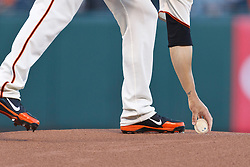 SAN FRANCISCO, CA - AUGUST 13: Ryan Vogelsong #32 of the San Francisco Giants picks up a baseball from the pitchers mound before the game against the Washington Nationals at AT&T Park on August 13, 2012 in San Francisco, California. The Washington Nationals defeated the San Francisco Giants 14-2. (Photo by Jason O. Watson/Getty Images) *** Local Caption *** Ryan Vogelsong
