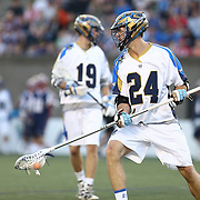 Ryan Flanagan #24 of the Charlotte Hounds controls the ball during the game at Harvard Stadium on May 17, 2014 in Boston, Massachuttes. (Photo by Elan Kawesch)