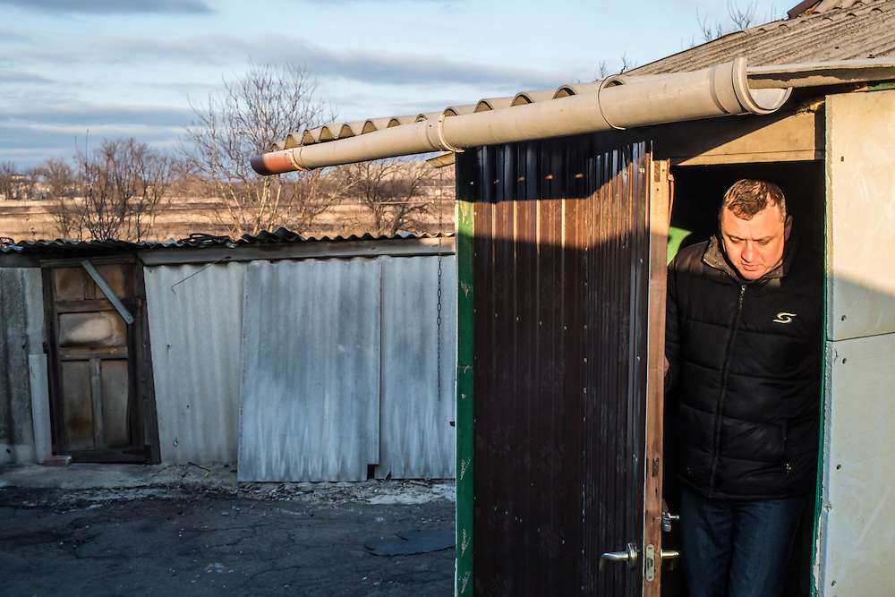 MARIINKA, UKRAINE - FEBRUARY 20, 2016:  Pastor Sergei Kosyak of the Christian Help Center of the Church of the Transfiguration walks out of his house in Mariinka, Ukraine. His house looks out over a field toward territory held by pro-Russian rebels just a few hundred meters away. The Donetsk suburb has been the scene of some of the heaviest fighting recently between Ukrainian forces and pro-Russian rebels. CREDIT: Brendan Hoffman for The New York Times