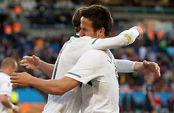 Milivoje Novakovic of Slovenia and Zlatan Ljubijankic of Slovenia celebrate after Ljubijankic scored during the 2010 FIFA World Cup South Africa Group C match between Slovenia and USA at Ellis Park Stadium on June 18, 2010 in Johannesberg, South Africa. (Photo by Vid Ponikvar / Sportida)