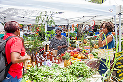 "Jeanne Fatie Delsoin sells produce and plants.  ""Alvin's Cultural Workshop"" Cultural Fair honoring Mr. Alvin Turnbull.  Emancipation Garden.  St. Thomas, VI.  29 April 2015.  © Aisha-Zakiya Boyd"