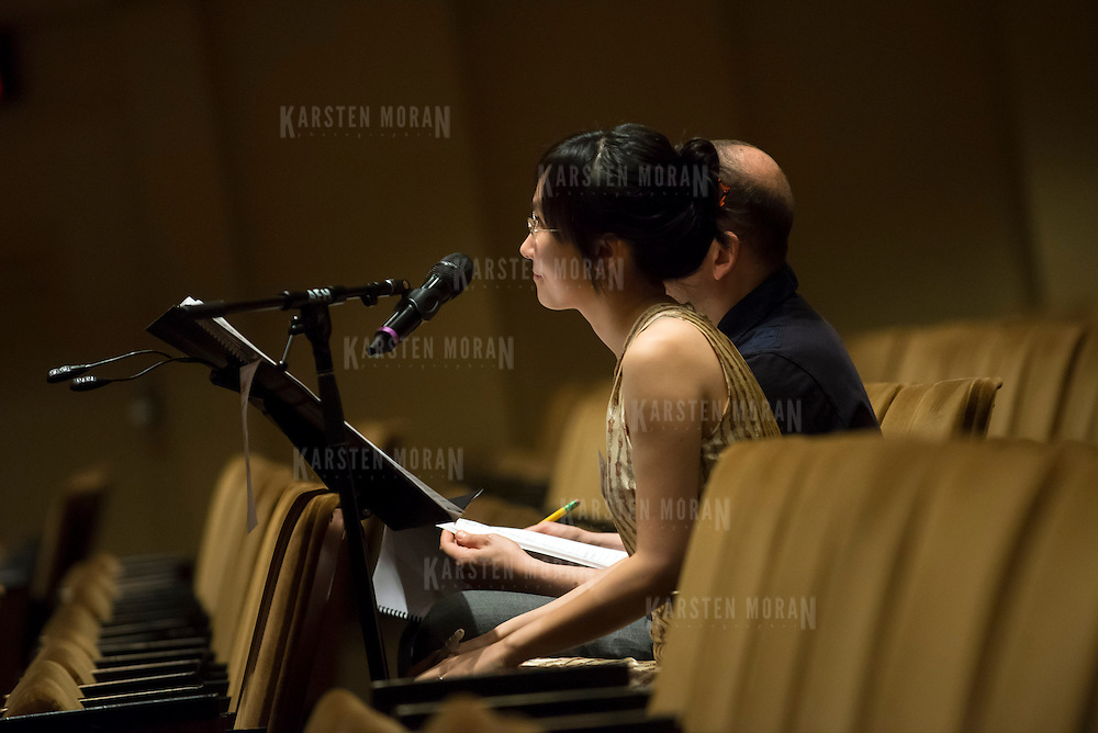 June 3, 2014 - New York, NY : Composer Wang Lu, foreground, works with mentor composer Derek Bermel (obscured) during a rehearsal of McManus's composition by the New York Philharmonic at Avery Fisher Hall on Tuesday. Three works by little-known composers, such as Lu, will be selected for inclusion in the New York Philharmonic's Biennial. CREDIT: Karsten Moran for The New York Times