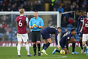 Referee Kevin Friend shows a yellow card to Burnley defender Ben Mee (6) during the Premier League match between Burnley and West Ham United at Turf Moor, Burnley, England on 9 November 2019.