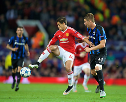 MANCHESTER, ENGLAND - Tuesday, August 18, 2015: Manchester United's Javier Hernandez in action against Club Brugge's Brandon Mechele during the UEFA Champions League Play-Off Round 1st Leg match at Old Trafford. (Pic by David Rawcliffe/Propaganda)