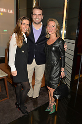 Left to right, ?, ? and Anouschka Menzies  at a party to celebrate Stuart Semple as artist in residence at The Bulgari Hotel held at Il Bar, Bulgari Hotel, 171 Knightsbridge, London on 14th October 2015.