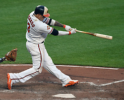 August 23, 2017 - Baltimore, MD, USA - The Baltimore Orioles' Manny Machado follows through on his 12th inning walk-off home run against the Oakland Athletics at Oriole Park at Camden Yards in Baltimore on Wednesday, Aug. 23, 2017. The Orioles won, 8-7, in 12 innings. (Credit Image: © Kenneth K. Lam/TNS via ZUMA Wire)