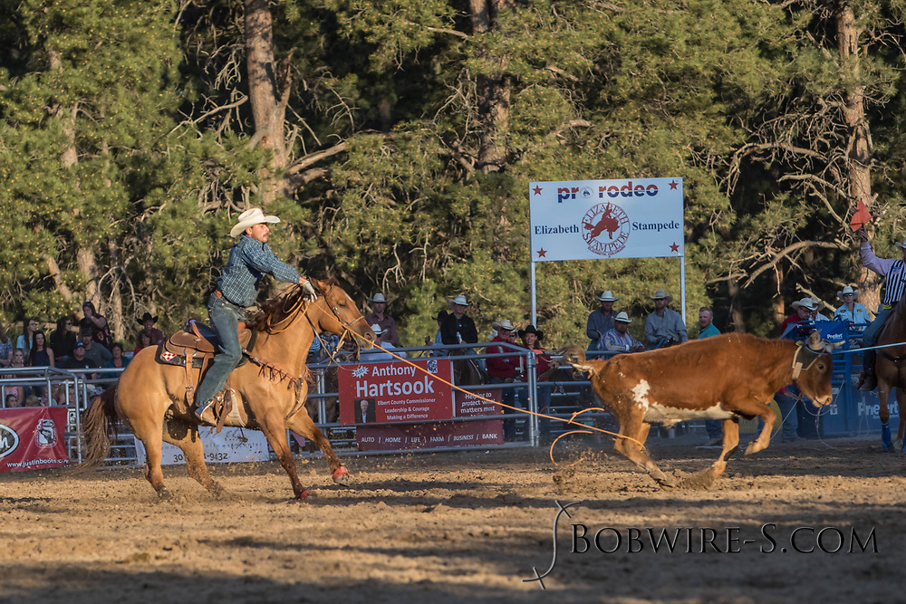Header XXXX and heeler XXXX make their team roping run during the second performance of the Elizabeth Stampede on Saturday, June 2, 2018.