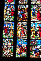Milan, Italy, Duomo Cathedral. Stained glass window - small panes, each with it's own scene.