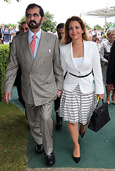 Sheikh Mohammed bin Rashid Al Maktoum and his wife Princess Haya on the second day of Glorious Goodwood in the UK, Wednesday, 31st July 2013<br /> Picture by Stephen Lock / i-Images
