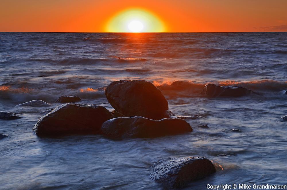 Waves and rocks on Lake Winnipeg at sunset<br /> Hillside Beach<br /> Manitoba<br /> Canada