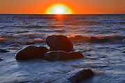 Waves and rocks on Lake Winnipeg at sunset<br /> Hillside Beach<br /> Manitoba<br /> Canada